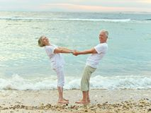 Couple standing on beach Royalty Free Stock Photo