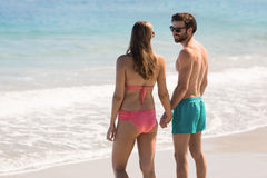 Couple standing on beach Stock Image
