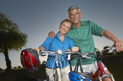Couple Standing With Bicycles royalty free stock photos