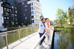 Couple standing on the bridge in new residential area Stock Photos
