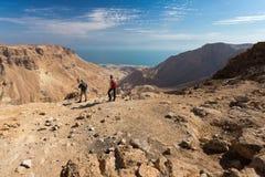 Couple standing desert mountain edge. Stock Photos