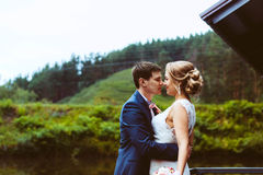 The couple standing on the dock Royalty Free Stock Photo