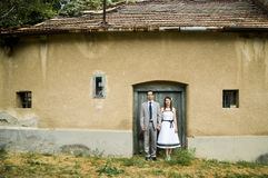 Couple standing on the door of a house. Stock Image