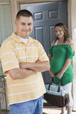 Couple Standing At Doorway Royalty Free Stock Image