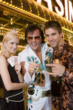 Couple Standing With Elvis Presley Impersonator Royalty Free Stock Image