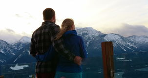 Couple standing and embracing each other on snowy landscape stock video