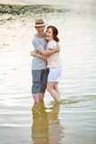 Couple standing with feet in water Stock Image