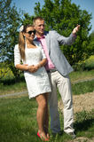 Couple standing in field Stock Images
