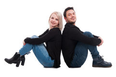 Couple standing on the floor back to back Royalty Free Stock Photos