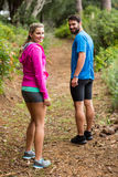Couple standing in forest Stock Photos