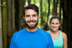 Couple standing in forest Royalty Free Stock Photos