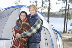 Couple Standing In Front Of Camp Tent Royalty Free Stock Photography
