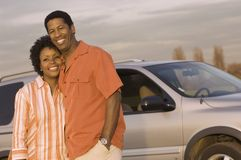 Couple Standing In Front Of The Car Stock Image