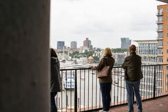 Couple standing in front of a handrail royalty free stock photo
