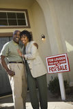 Couple Standing In Front Of New House royalty free stock photos