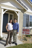 Couple Standing In Front Of New House Stock Image