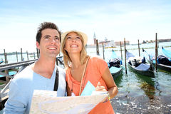 Couple standing in front of San Giorgio Maggiore Island Royalty Free Stock Photography