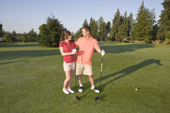 Couple Standing on Golf Course - Horizontal Royalty Free Stock Image