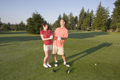 Couple Standing on Golf Course - Horizontal Stock Photos