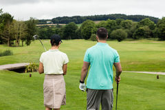 Couple standing on a golf course Royalty Free Stock Photo