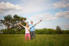 Couple standing on grass Stock Image