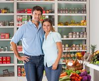 Couple Standing In Grocery Store Stock Images