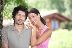 Couple standing by holiday cabin Royalty Free Stock Photography