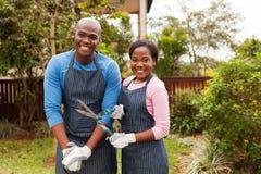 Couple standing home garden Stock Image