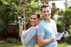 Couple standing home garden Stock Images