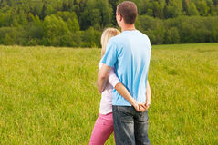 Couple standing and hugging in nature Royalty Free Stock Photos