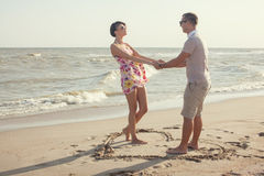 Couple standing inside heart Royalty Free Stock Images