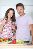 Couple standing in kitchen Royalty Free Stock Image