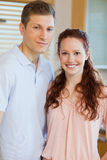 Couple standing in the kitchen. Together Stock Image