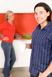 Couple standing in kitchen Royalty Free Stock Photos