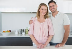 Couple standing at kitchen counter Stock Image