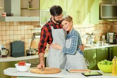 Couple standing in the kitchen. People at the cooking table royalty free stock photos