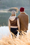 Couple standing lake Royalty Free Stock Photography