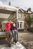 Couple Standing By Moving Van In Front Of New Home royalty free stock photography