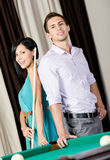 Couple standing near billiard table Stock Photography