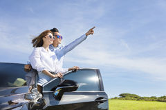couple standing near the car and enjoy summer vacation Stock Images