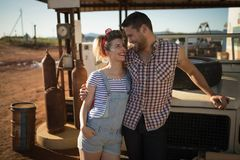 Couple standing near a car at petrol pump. Romantic couple standing near a car at petrol pump royalty free stock photos