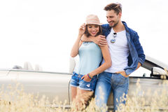 Couple standing near convertible Royalty Free Stock Image