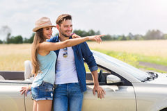 Couple standing near convertible Stock Photo