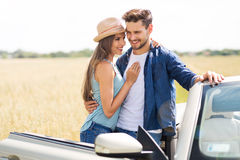 Couple standing near convertible Royalty Free Stock Photography