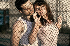 Couple standing near lattice Stock Photos