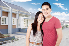 Couple standing near the new home Stock Images