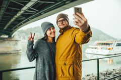 Couple standing near river boat with mountain on bckground. In fog Stock Images