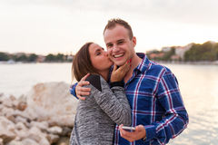 Couple standing near seashore, they are in love. Stock Photos