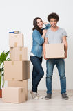 Couple Standing Near Stack Of Boxes Stock Photos