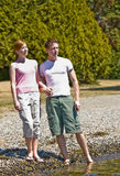 Couple standing near stream Stock Images